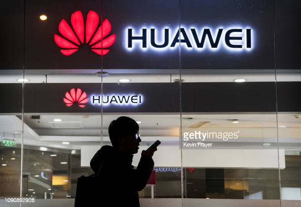 A pedestrian talks on the phone while walking past a Huawei Technologies Co store on January 29 2019 in Beijing China The US Justice Department filed...