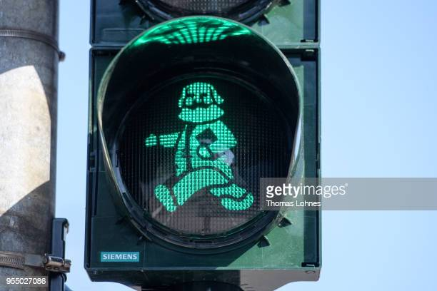 A pedestrian traffic light with the German philosopher and revolutionary Karl Marx pictured on the 200th anniversary of the birth of Karl Marx on May...