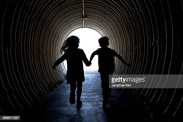 Pedestrian tunnel passageway into a park.
