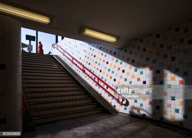 Pedestrian underpass with colorful tiled wall at village railway station