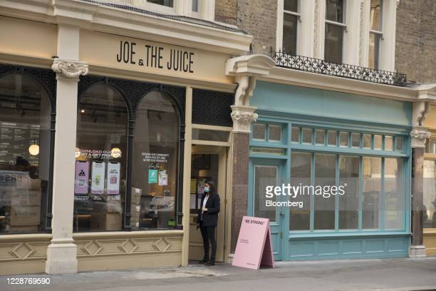 Pedestrian waits for an order outside a juice bar in London, U.K., on Monday, Sept. 28, 2020. Londoners are looking for jobs outside the capital as...