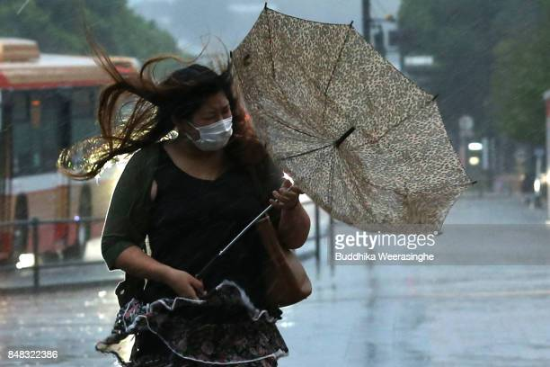 A pedestrian walk in the heavy rain and strong wind as Typhoon Talim approaches to western Japan on September 17 2017 in Himeji Hyogo Japan Japan's...