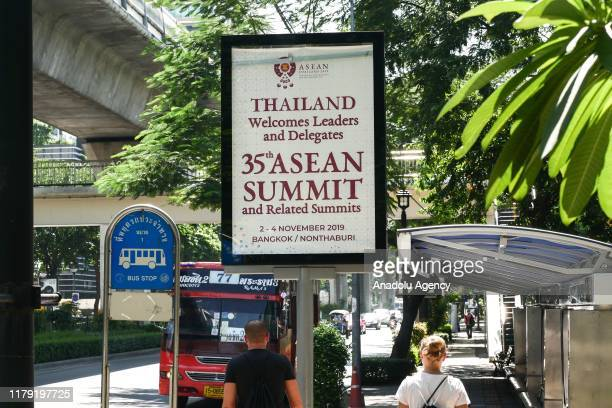 Pedestrian walk near the 35th ASEAN Summit welcoming sign at Ratchadamri in Bangkok Thailand on October 31 2019 Thailand will host the annual meeting...