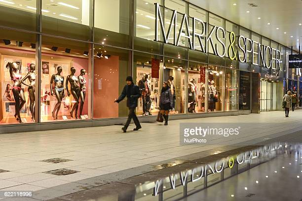 Pedestrian walk past a fashion store of Marks amp Spencer in Krakow Poland on 9 November 2016 Marks amp Spencer is exiting from 10 countries and...