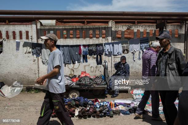 Pedestrian walk past a stall at a market in Dushanbe Tajikistan on Sunday April 22 2018 Flung into independence after the Soviet Union collapsed in...