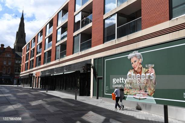 A pedestrian walk past closed shops in an empty retail area in the centre of Leicester central England on July 17 as local lockdown restrictions...