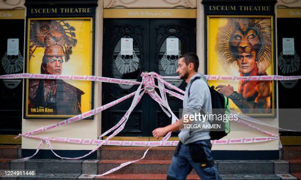 A pedestrian walkd past the Lyceum Theatre which remains closed due to restrictions to slow the spread of the novel coronavirusm in London's West End...