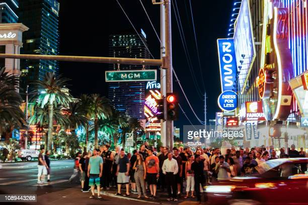 pedestrian walking in las vegas night - red light stock pictures, royalty-free photos & images