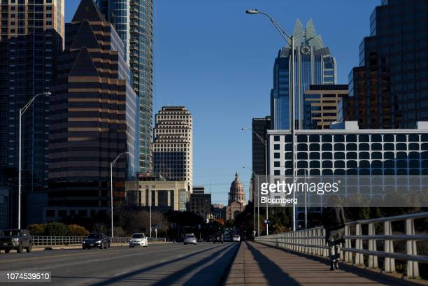A pedestrian walks across an overpass in downtown Austin Texas US on Thursday Dec 20 2018 Apple Inc announced this month it's opening new offices in...