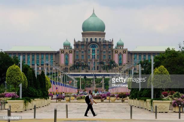 A pedestrian walks across Putrajaya Boulevard near the Perdana Putra the office complex of the Prime Minister of Malaysia in Putrajaya Malaysia on...