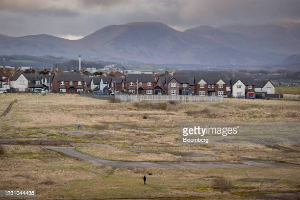 Pedestrian walks across the proposed site of a new coal mine in Whitehaven, U.K., on Monday, Feb. 8, 2021. The U.K. Government backed the new mine...
