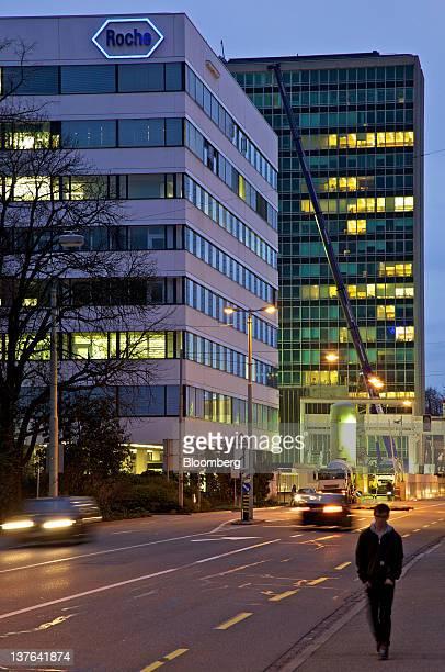 A pedestrian walks along a side walk near Roche Holding AG's headquarters in Basel Switzerland on Monday Jan 23 2012 US regulators approved Roche's...