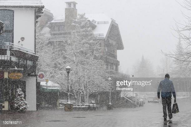 A pedestrian walks along an empty street in Vail Colorado US on Thursday March 19 2020 Colorado GovernorJared Polisordered the closing of all ski...