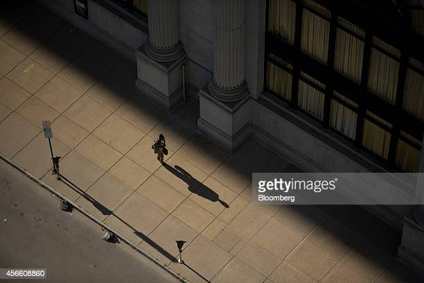 Pedestrian walks along Genesee Street in Buffalo, New York, U.S., on Wednesday, Sept. 24, 2014. The Federal Reserve Bank of New York's empire state...