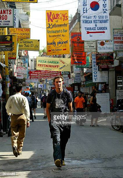 A pedestrian walks along the usually busy tourist area of Thamel May 18 2003 in Kathmandu Nepal With a ceasefire holding between the government and...