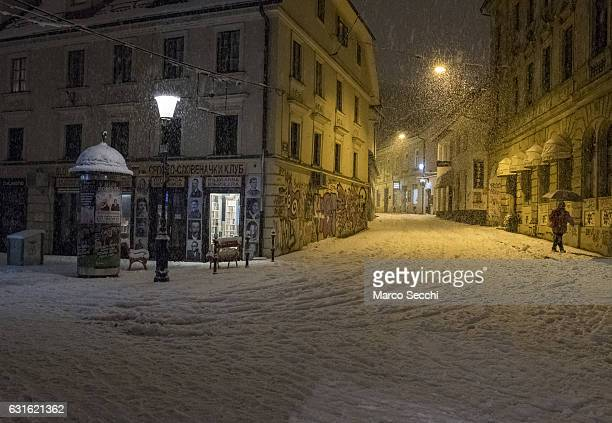 A pedestrian walks along Trubarjeva on January 13 2017 in Ljubljana Slovenia Most of Slovenia was covered by heavy snowfalls for the first time this...