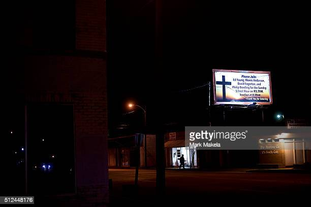 A pedestrian walks below a billboard advertising sunday school radio across the street from the Cumberland United Methodist Church where Democratic...