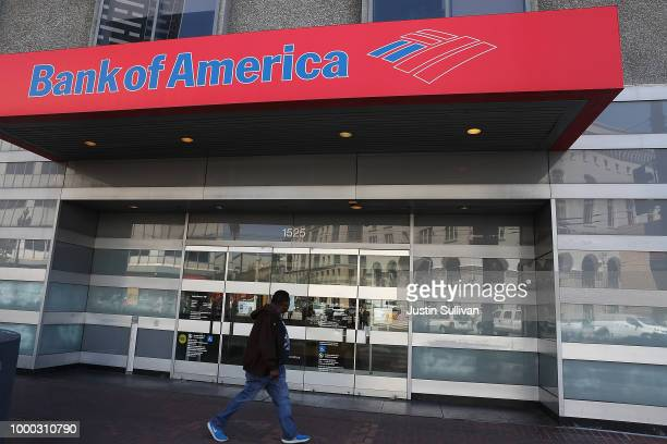 A pedestrian walks by a Bank of America office on July 16 2018 in San Francisco California Bank of America reported stronger than epxpected second...