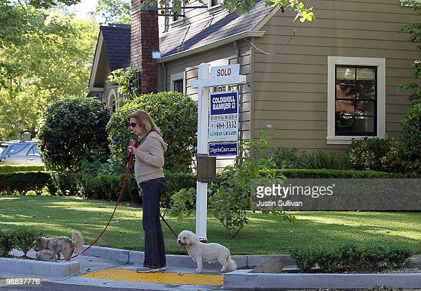 A pedestrian walks by a home with sold sign posted in front May 4 2010 in San Anselmo California The National Association of Realtors reported today...