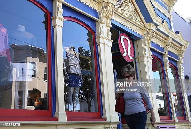 Pedestrian walks by a Lululemon retail store on September 12, 2014 in San Francisco, California. Athletic clothing retailer Lululemon Athletica Inc....