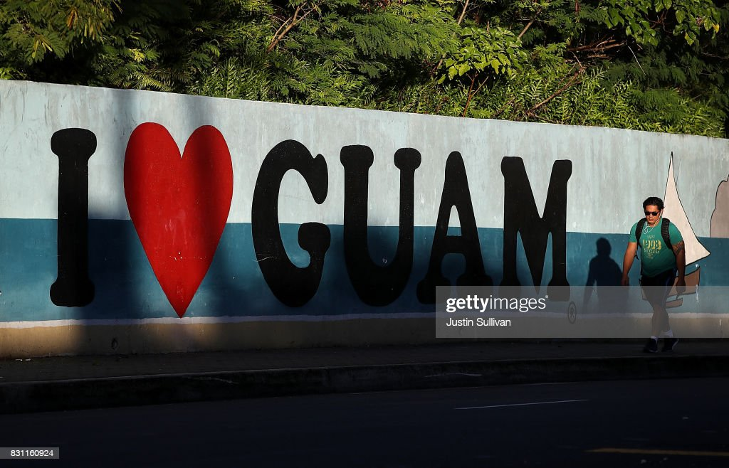 A pedestrian walks by a mural on August 14, 2017 in Tamuning, Guam. The American territory of Guam remains on high alert as a showdown between the U.S. and North Korea continues. North Korea has said that it is planning to launch four missiles near Guam by the middle of August. Guam is home to about 7,000 American troops and 160,000 residents.