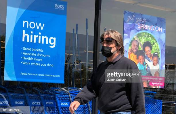 Pedestrian walks by a now hiring sign at Ross Dress For Less store on April 02, 2021 in San Rafael, California. According to a report by the Bureau...