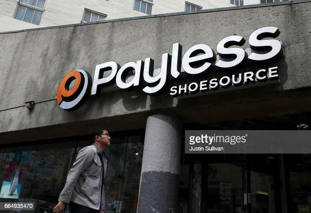 A pedestrian walks by a Payless Shoe Source store on April 5 2017 in San Francisco California Kansasbased discount shoe retailer Payless Shoe Source...