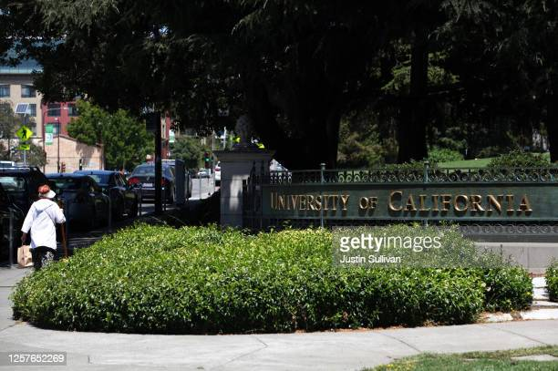 Pedestrian walks by a sign in front of the U.C. Berkeley campus on July 22, 2020 in Berkeley, California. U.C. Berkeley announced plans on Tuesday to...