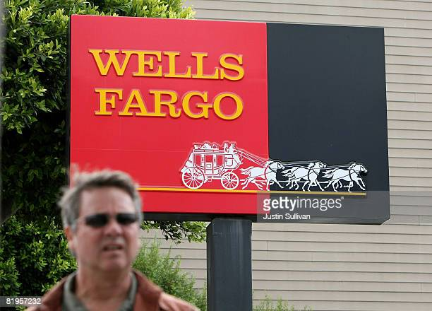 A pedestrian walks by a sign outside of a Wells Fargo Bank branch July 16 2008 in San Francisco California Wells Fargo the nation's fifth largest...