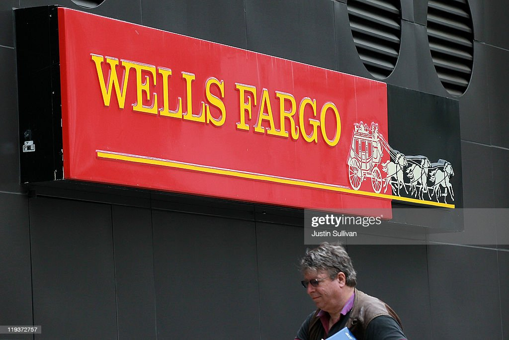 A pedestrian walks by a sign that is posted in front of a Wells Fargo Bank branch on July 19, 2011 in Oakland, California. San Francisco-based Wells Fargo & Co. reported a 30 percent surge in quarterly profits with earnings of $3.73 billion, or 70 cents per share compared to $2.88 billion, or 55 cents per share one year ago.