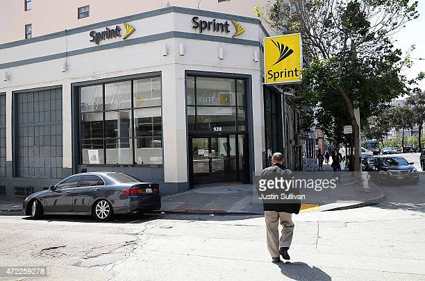 Pedestrian walks by a Sprint store on May 5, 2015 in San Francisco, California. Sprint reported a $224 million first-quarter loss with revenues...