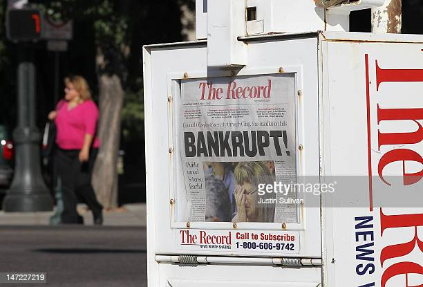 """Pedestrian walks by a Stockton Record newspaper rack displaying the headline """"Bankrupt!"""" on June 27, 2012 in Stockton, California. Members of the..."""