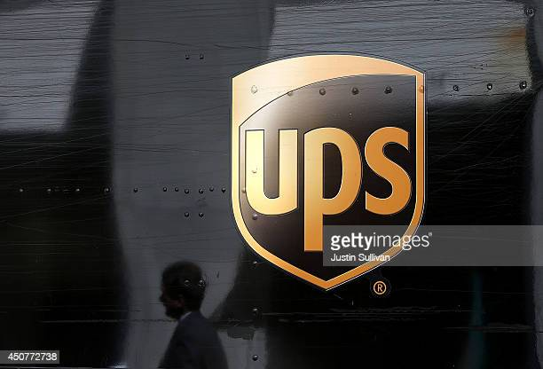 A pedestrian walks by a United Parcel Service truck on June 17 2014 in San Francisco California UPS announced plans to begin to consider box size in...