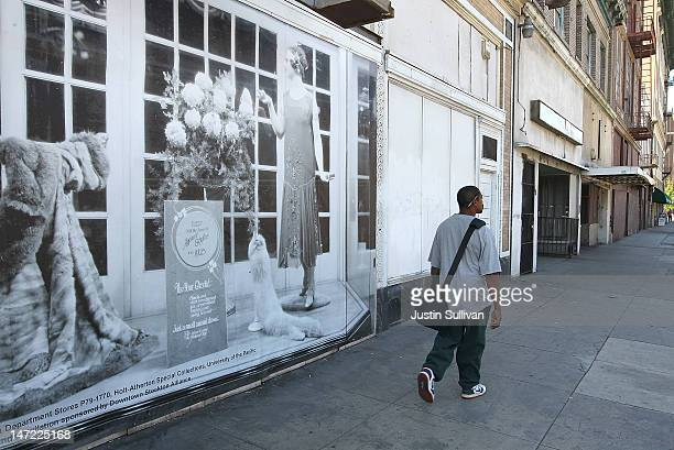 Pedestrian walks by a vintage photograph that is posted on a vacant building on June 27, 2012 in Stockton, California. Members of the Stockton city...