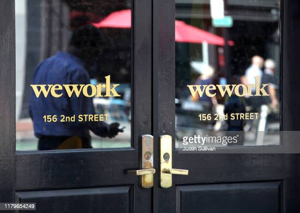 Pedestrian walks by a WeWork office on October 07, 2019 in San Francisco, California. Days after withdrawing its registration for an initial public...
