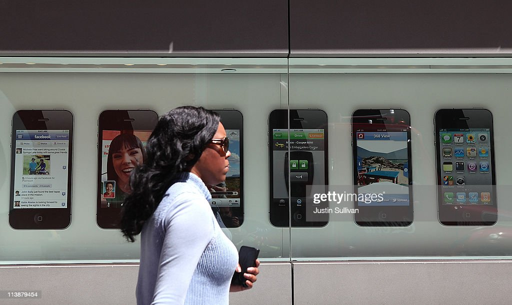 A pedestrian walks by a window display featuring the iPhone 4 at an Apple Store following an announcement that Apple has become the world's most valuable brand on May 9, 2011 in San Francisco, California. In a report released by London based Millward Brown, Apple Inc. has surpassed Google to claim the top spot in a global ranking of brand value this year with an estimated value of more than $153 billion up 84 percent from last year.