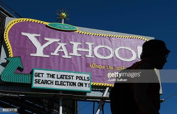 A pedestrian walks by a Yahoo billboard October 21 2008 in San Francisco California Yahoo announced today that it will cut at least 1400 jobs from...