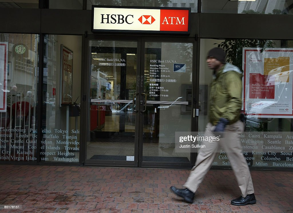 A pedestrian walks by an HSBC bank branch March 2, 2009 in San