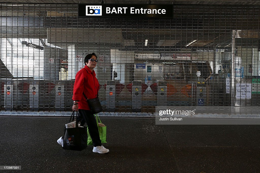 A pedestrian walks by closed pay gate at the Bay Area Rapid Transit (BART) Daly City station on July 3, 2013 in Daly City, California. For a third day, hundreds of thousands of San Francisco Bay Area commuters are scrambling to find ways to work as two of San Francisco Bay Area Rapid Transit's (BART) largest unions remain on strike while they continue contract negotiations with management. Train operators, mechanics, station agents and maintenance workers are seeking a five percent wage increase and are fighting management who want to have workers to begin contributing to their pensions, pay more for health insurance and reduce overtime expenses.