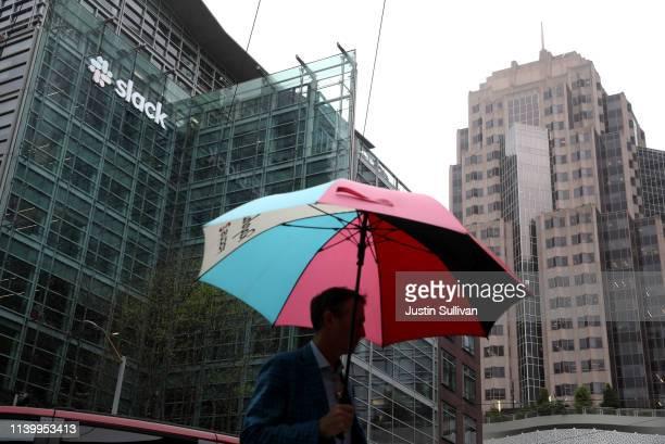 Pedestrian walks by Slack headquarters on April 02, 2019 in San Francisco, California. Workplace messaging company Slack Technologies Inc. Announced...