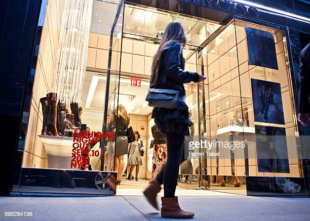A pedestrian walks by the Jimmy Choo flagship store on Madison Avenue during the second annual Fashion's Night Out in New York City on Friday...