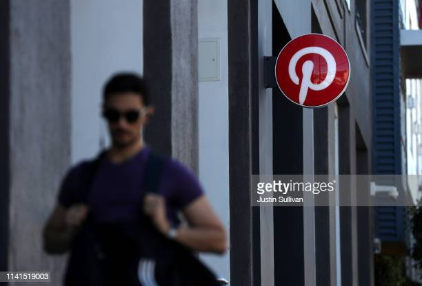 A pedestrian walks by the Pinterest headquarters on April 09 2019 in San Francisco California Social sharing site Pinterest is preparing for its...