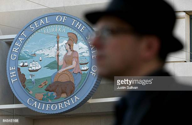 A pedestrian walks by the State of California building January 29 2009 in San Francisco California California Governor Arnold Schwarzenegger will...