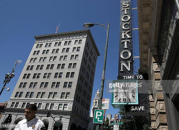 Pedestrian walks by the vacant Bank of Stockton on June 27, 2012 in Stockton, California. Members of the Stockton city council voted 6-1 on Tuesday...