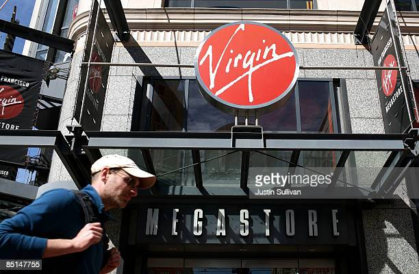 A pedestrian walks by the Virgin Megastore February 27 2009 in the Union Square shopping district of San Francisco California As the recession...