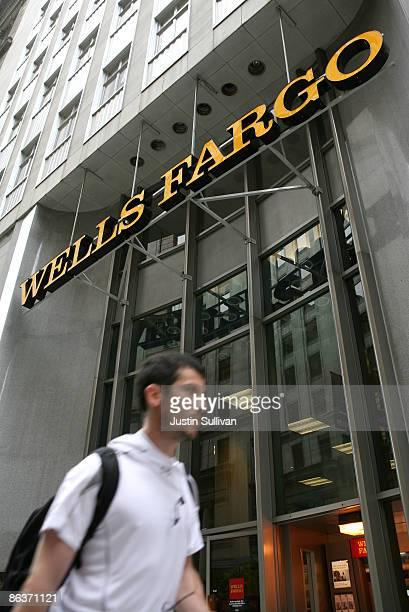 A pedestrian walks by the Wells Fargo headquarters May 4 2009 in San Francisco California Regulators have notified Wells Fargo Bank that it might...
