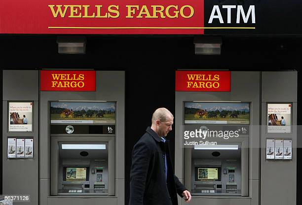 A pedestrian walks by Wells Fargo ATMs May 4 2009 in San Francisco California Regulators have notified Wells Fargo Bank that it might need to firm up...