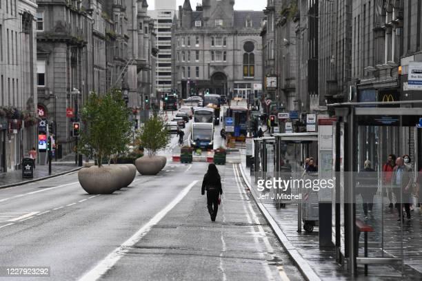 Pedestrian walks down an empty street on August 5, 2020 in Aberdeen, Scotland. Scotland's First Minister Nicola Sturgeon acted swiftly and put...