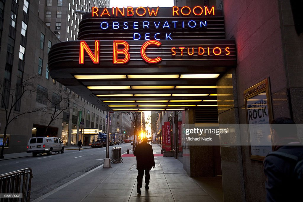 A pedestrian walks in front of NBC Studios on 50th Street on December 1, 2009 in New York City. General Electric is poised to buy Vivendi's NBC Universal stake.
