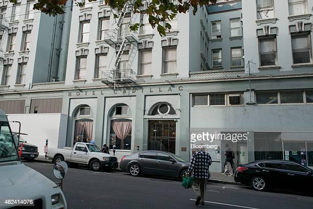 A pedestrian walks in front of the Hotel Cadillac in the Tenderloin district of San Francisco California US on Thursday Jan 15 2015 In a city where...
